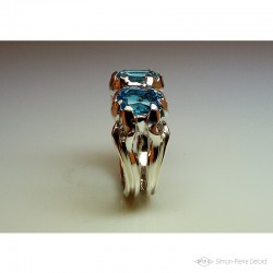 "Ring in Argentium, Aquamarine and Topaz. Title: ""Between two Seas"", Arts and Crafts Jeweler. Lost wax in direct carving"