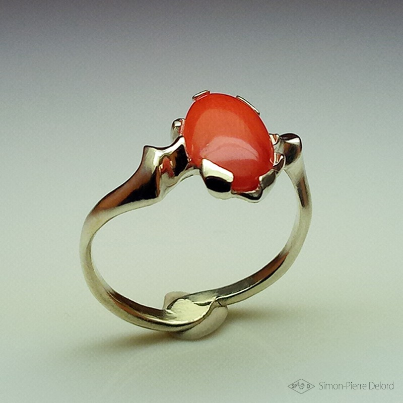 "Ring in Argentium and red coral. Title: ""Chtonic Wave"", Arts and Crafts Jeweler. Lost wax in direct carving"