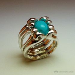"Ring in Argentium and turquoise. Title: ""Treasure of the Seas"", Arts and Crafts Jeweler. Lost wax in direct carving"