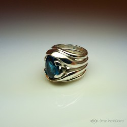 """Encyclical"", High Jewelry Ring, Topaz Blue London, Lost wax technique. Arts and Crafts"