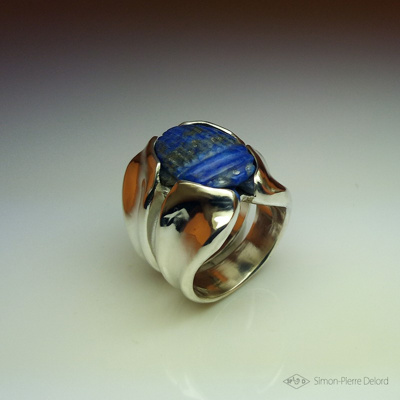 """Celestial Protection"", High Jewelry Ring, Scarab carved in Lapis lazuli, Lost wax technique. Arts and Crafts"